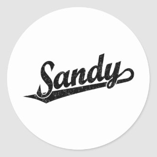 Sandy script logo in black distressed classic round sticker