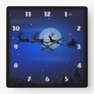 Santa and his reindeers flying at night square wall clock