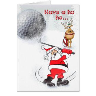 Santa and reindeer friend golfing. greeting card