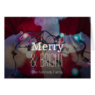 Santa Claus holding colored Christmas lights Greeting Card