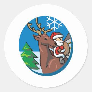 Santa Claus Rides Reindeer Round Sticker