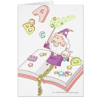 Santa Claus sitting on book Card
