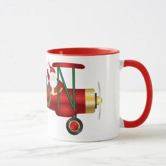 Santa Claus Waving on Biplane with Gifts Mug
