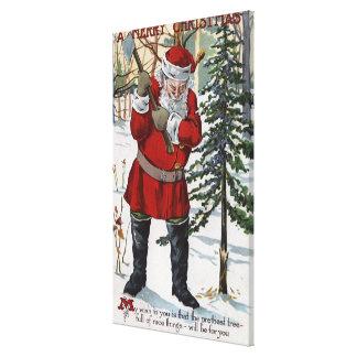 Santa Cutting Down Christmas Tree Stretched Canvas Print
