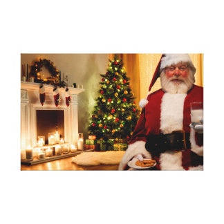 Santa enjoying some milk and cookies canvas print