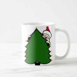 Santa Hides Behind Christmas Tree Coffee Mug