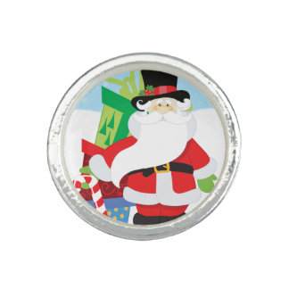 santa in tophat by  stack of presentts ring