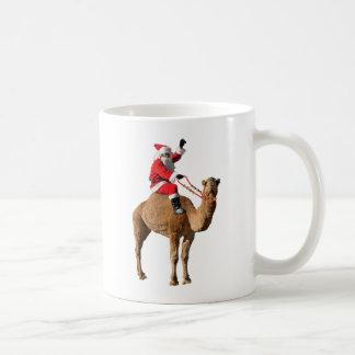 Santa On Camel Christmas Mugs