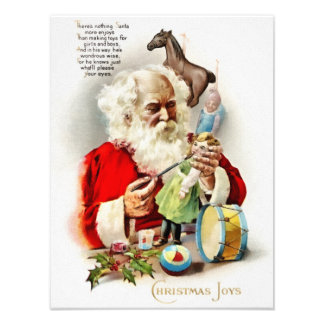 Santa putting the final touches of paint on a doll photo