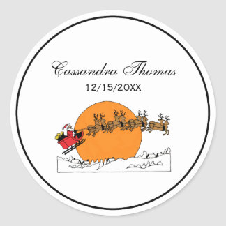 Santa Reindeer Over Snow Covered Town Moon Classic Round Sticker