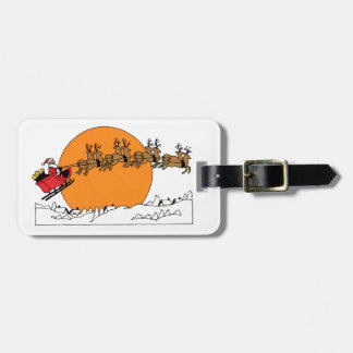 Santa Reindeer Over Snow Covered Town Moon Luggage Tag