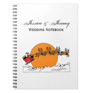Santa Reindeer Over Snow Covered Town Moon Notebook
