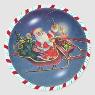 SANTA, SLEIGH & CANDY CANE WREATH by SHARON SHARPE Classic Round Sticker