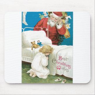 Santa watching girl praying mousepad