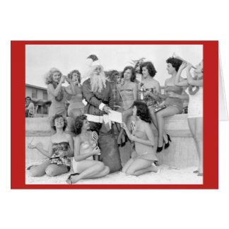 Santa with young women on beach card