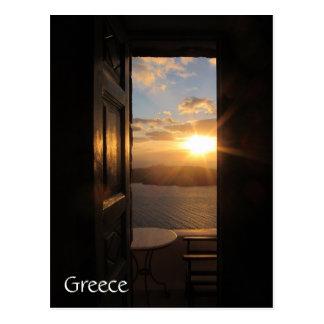 Santorini sunset through door postcard