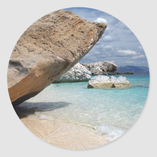 Sardinia beach with big rocks round sticker