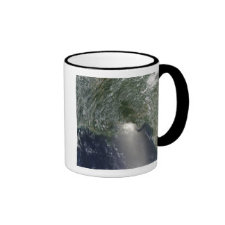 Satellite view of an oil spill coffee mugs