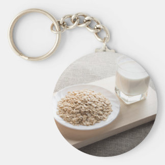 Saucer of cereal and a glass of milk in the backli key ring