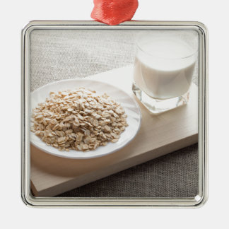 Saucer of cereal and a glass of milk in the backli Silver-Colored square decoration