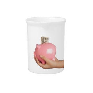 Savings in piggy bank drink pitchers