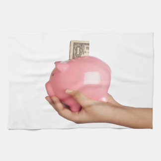 Savings in piggy bank kitchen towels