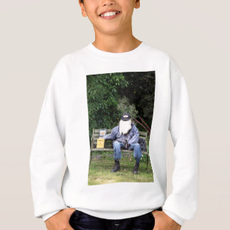 Scarecrow on bench with beer sweatshirt