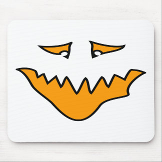 Scary Face. Monster Grin in Orange. Mousepad
