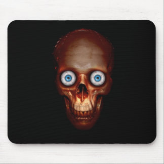 Scary skull in the dark mouse pad