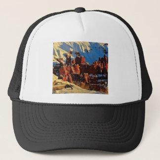 scenes of the snowy red rock trucker hat