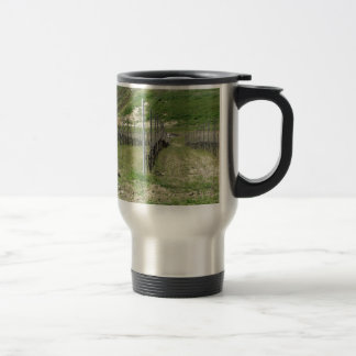 Scenic view of rolling hillside with vineyards travel mug