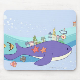 School of fishes swimming in underwater town mouse pad
