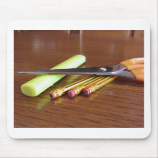 School office supplies on wooden table mouse pad