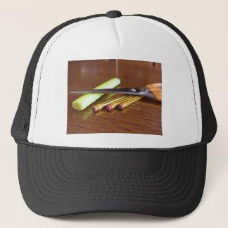 School office supplies on wooden table trucker hat