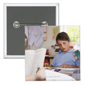 schoolgirl concentrating on reading in class pinback buttons