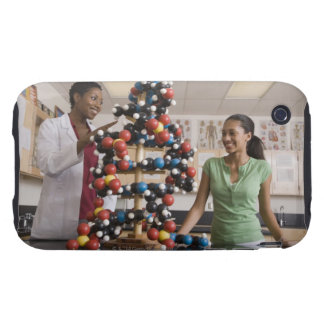 Science teacher and teenage girl looking at tough iPhone 3 cases