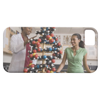 Science teacher and teenage girl looking at iPhone 5 case