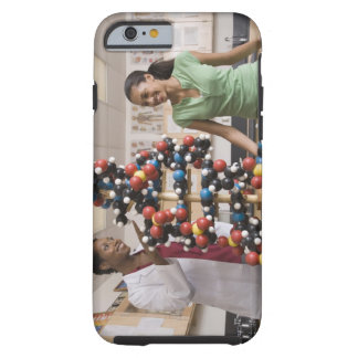 Science teacher and teenage girl looking at tough iPhone 6 case