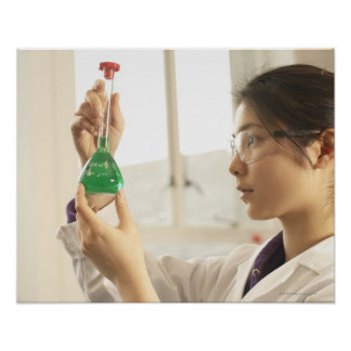 Scientist examining liquid in beaker poster