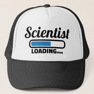 Scientist loading trucker hat