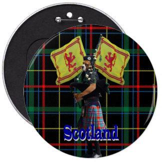 Scottish piper on tartan pinback button