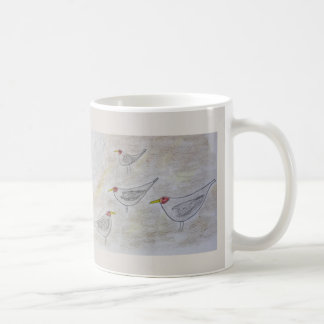 Sea birds on the beach coffee mug