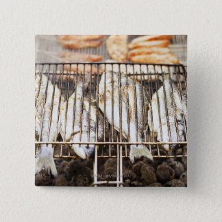 Sea breams on barbecue grill. 15 cm square badge