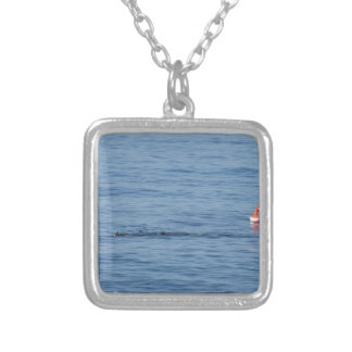 Sea diver in scuba suit swim in water silver plated necklace
