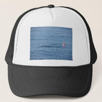 Sea diver in scuba suit swim in water trucker hat