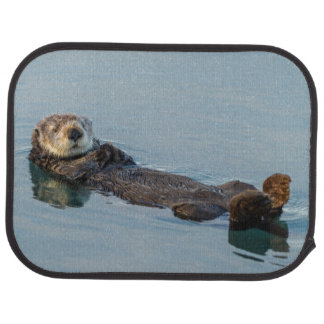 Sea otter floating on back in ocean car mat