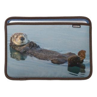 Sea otter floating on back in ocean sleeve for MacBook air