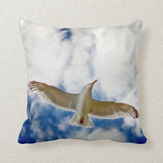 Seagul in flight with blue skies and white cloud, cushion