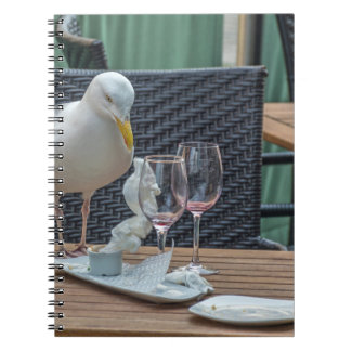 Seagull and empty glasses notebook