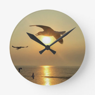 Seagull at Sunset Round Clock